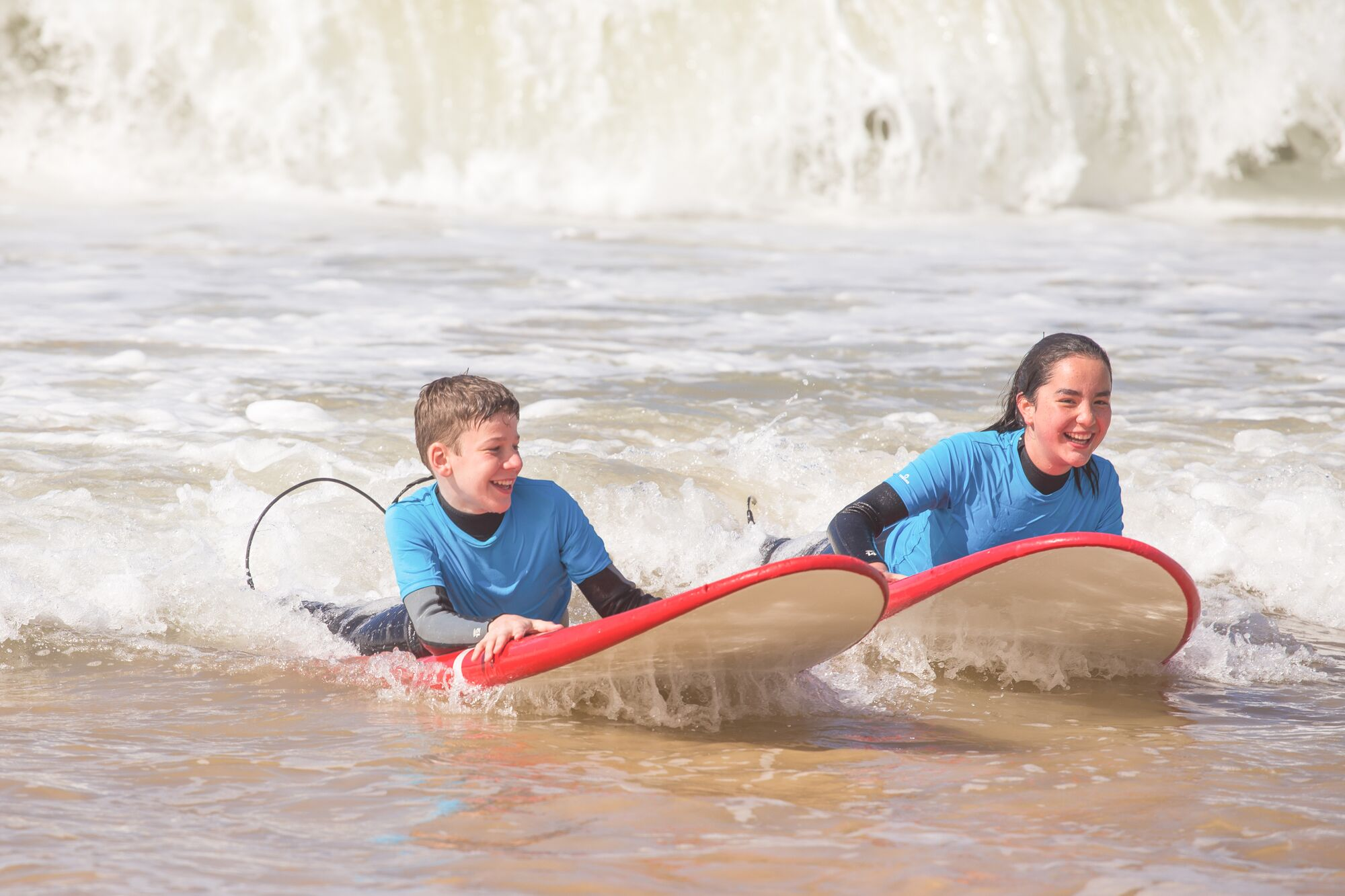 family surfing in the algarve